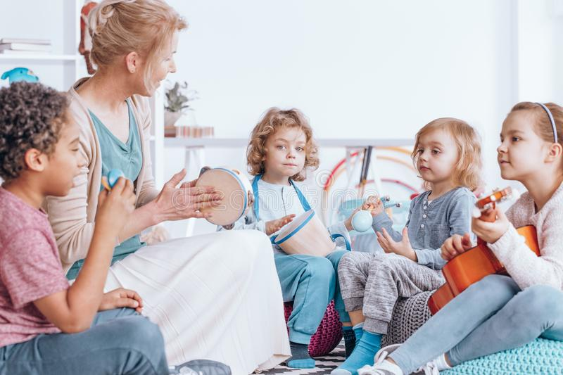Children playing musical instruments royalty free stock photo