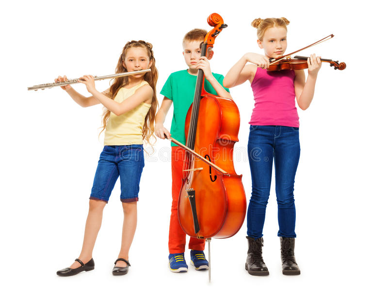 Children playing on musical instruments together. On white background stock images