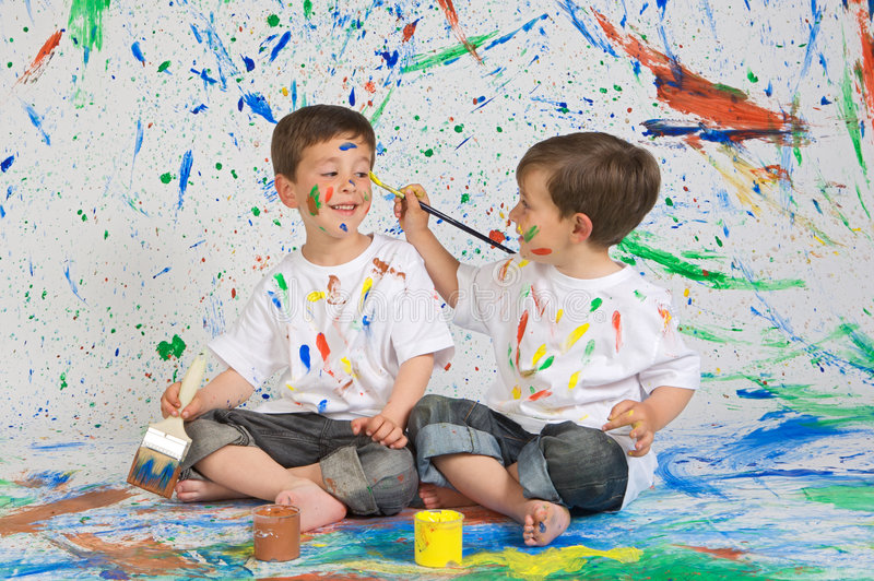 Children Playing With Painting Royalty Free Stock Image