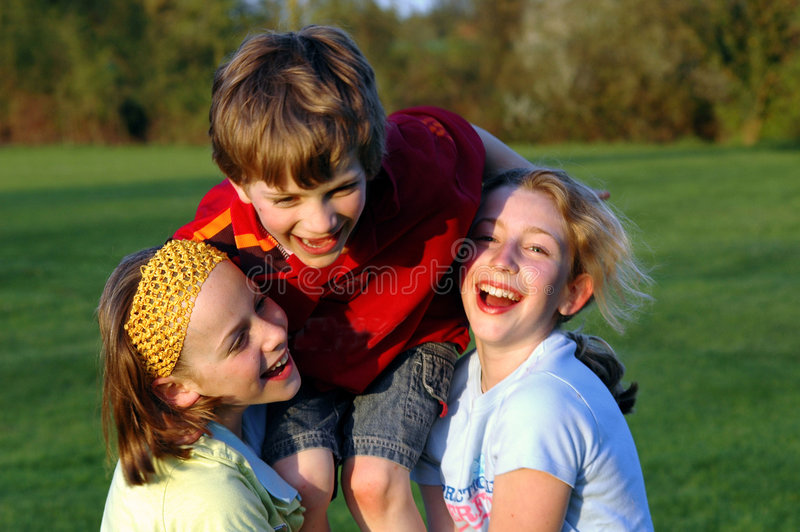 Children playing in the park. Lifestyle portrait of three children, outdoors, nikon D70 stock photo