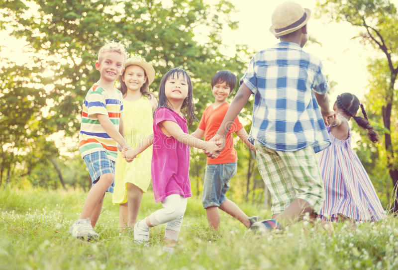 Children playing in the park Happiness Concept stock photography