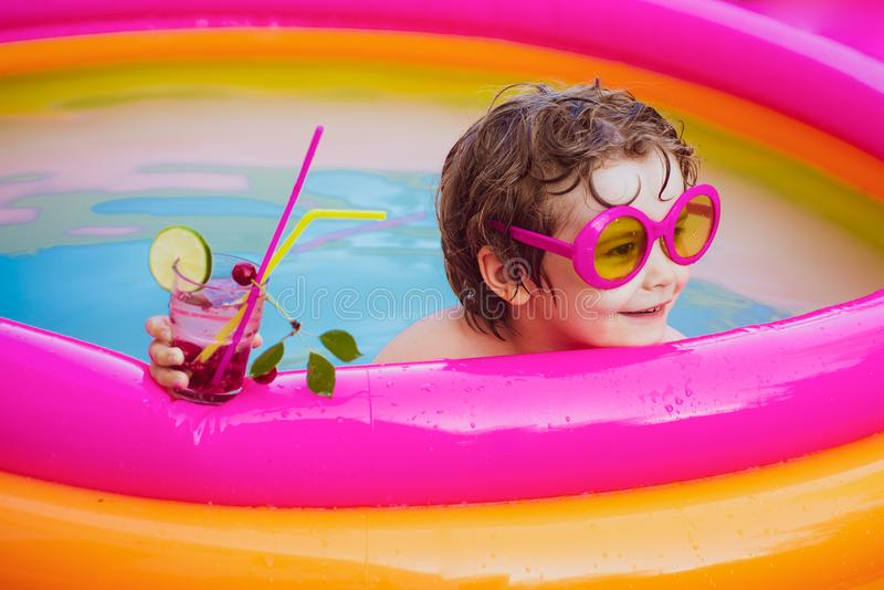 Children playing in pool. Summer holidays and vacation concept. Children play in tropical resort. Child having fun in. Summertime. Vacation at Paradise stock image