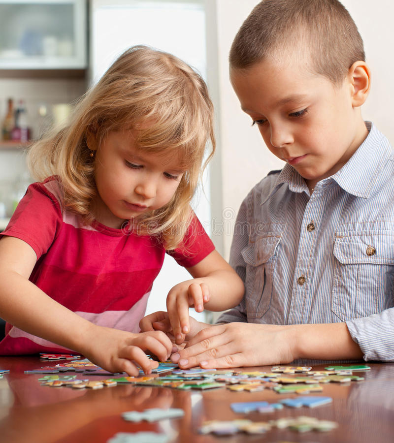 Kinder Garden: Children, Playing Puzzles Stock Photo. Image Of Elementary