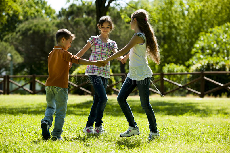 Children playing ring-around-the-rosy. Small group of children playing ring-around-the-rosy royalty free stock image