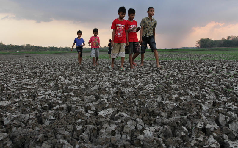 Children playing in the rumen Kerto Sragen, Central Java Indonesia. Dry season makes elevationn the reservoir is reduced so that the children used to look for royalty free stock photography