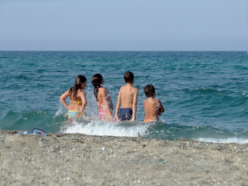 Children playing in sea royalty free stock image