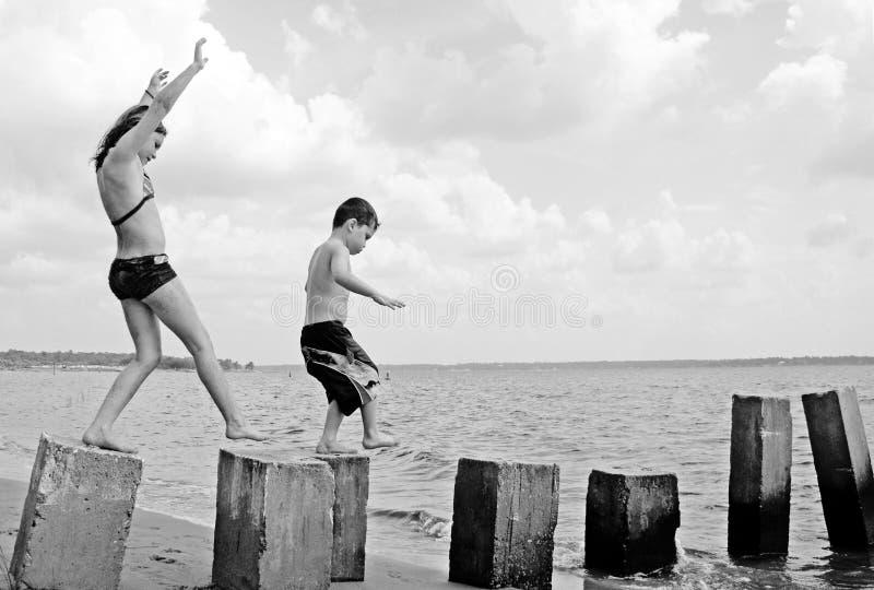 Children playing at seashore stock photo