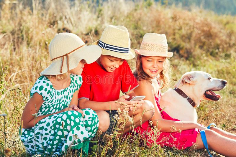 Children playing with smart phone stock images