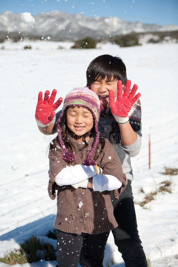 Children playing in snow royalty free stock photography
