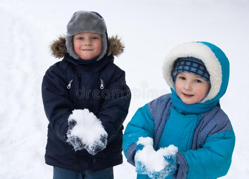 Children playing in snow royalty free stock image