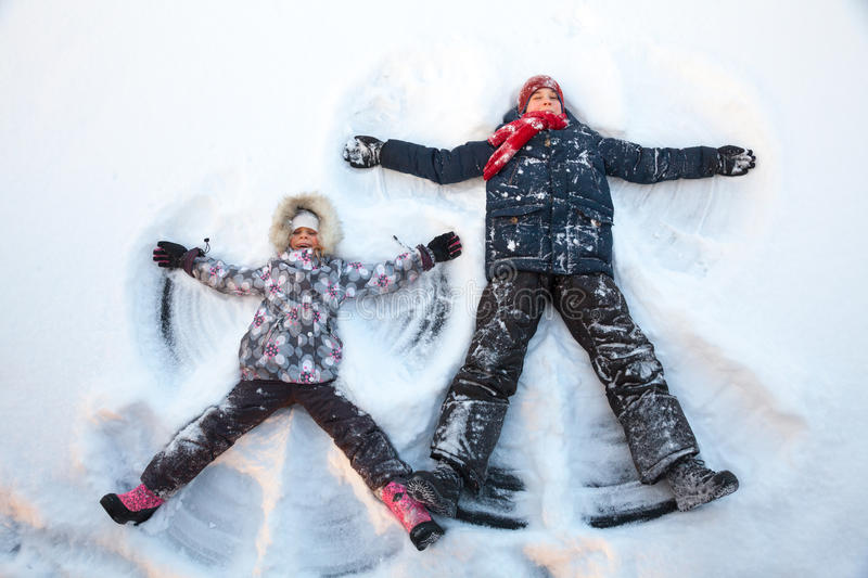 Children playing in a snow enjoying winter stock photography