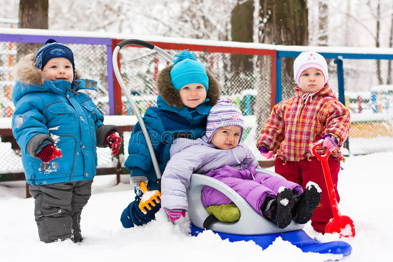 Children playing in snow outdoor stock images