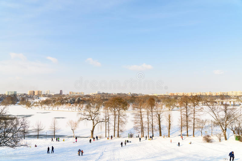 Children Playing With Snow After Snowfall On Winter Day In Tineretului Park Of Bucharest royalty free stock image
