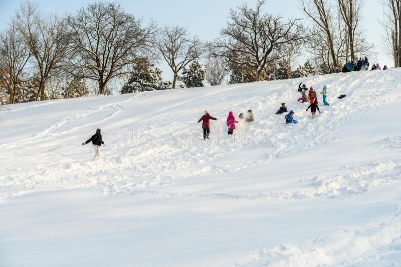 Children Playing With Snow After Snowfall On Winter Day In Tineretului Park Of Bucharest royalty free stock photography