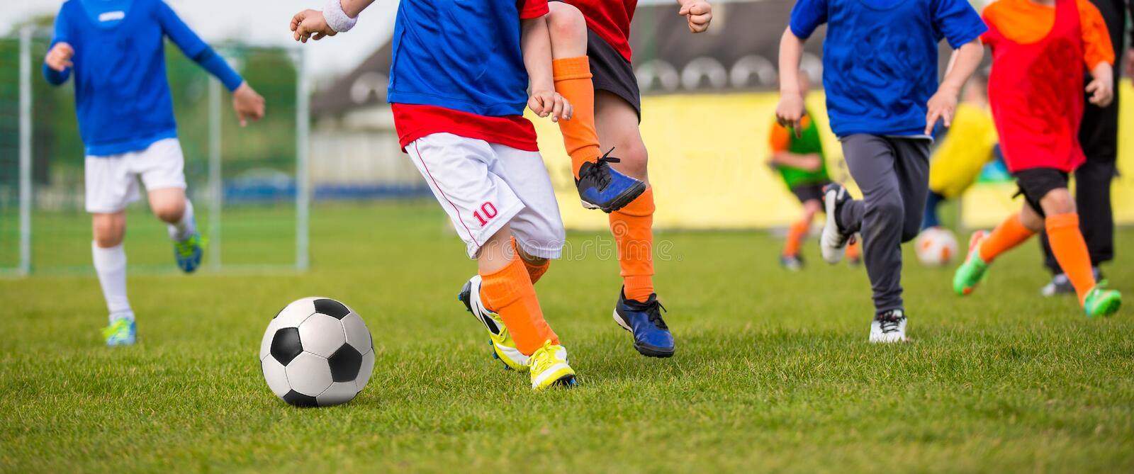Children playing soccer football match. Sport soccer horizontal stock photography