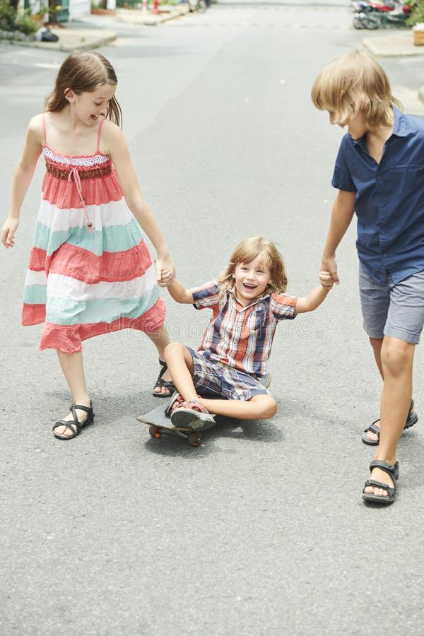 Children playing in the street royalty free stock images
