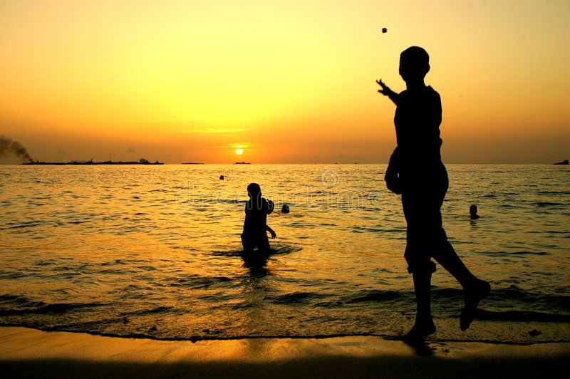 Children playing when sunsets royalty free stock image