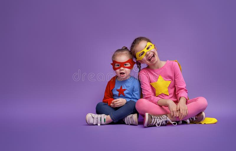 Children are playing superhero stock photography