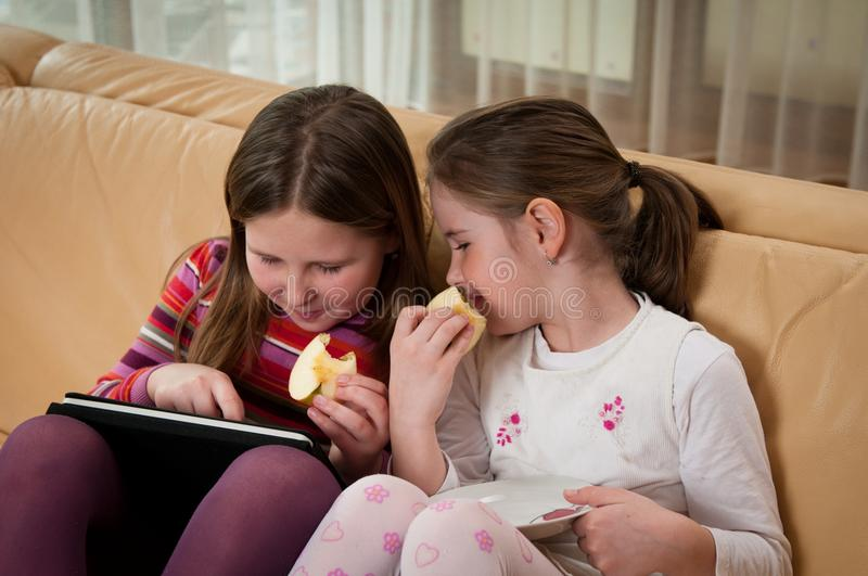 Children playing with tablet stock images