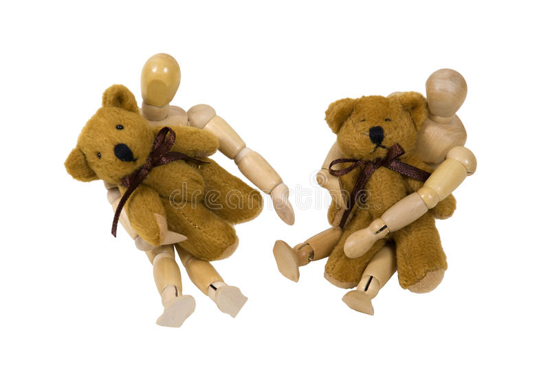 Children playing with teddy bears. Children sitting on the floor and playing together with teddy bears - path included stock photo