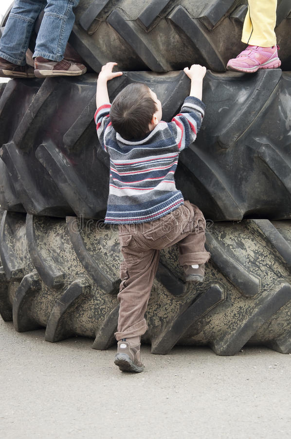 Download Children playing on tires stock photo. Image of tire - 24735260