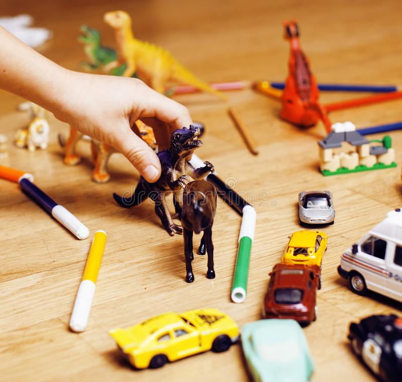 Children playing toys on floor at home, little hand in mess, free education stock image