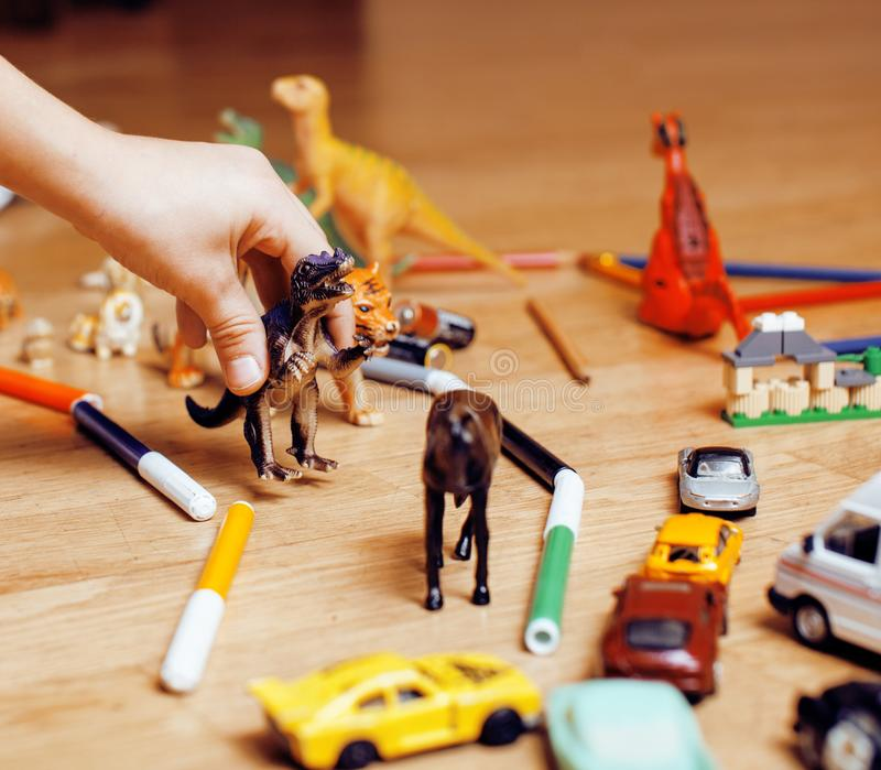 Children playing toys on floor at home, little hand in mess, free education stock photo