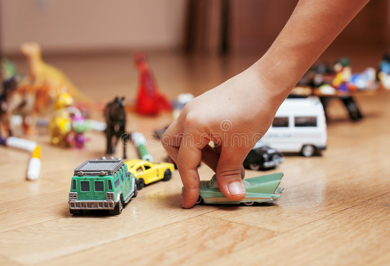 Children playing toys on floor at home, little. Hand in mess, free education stock images