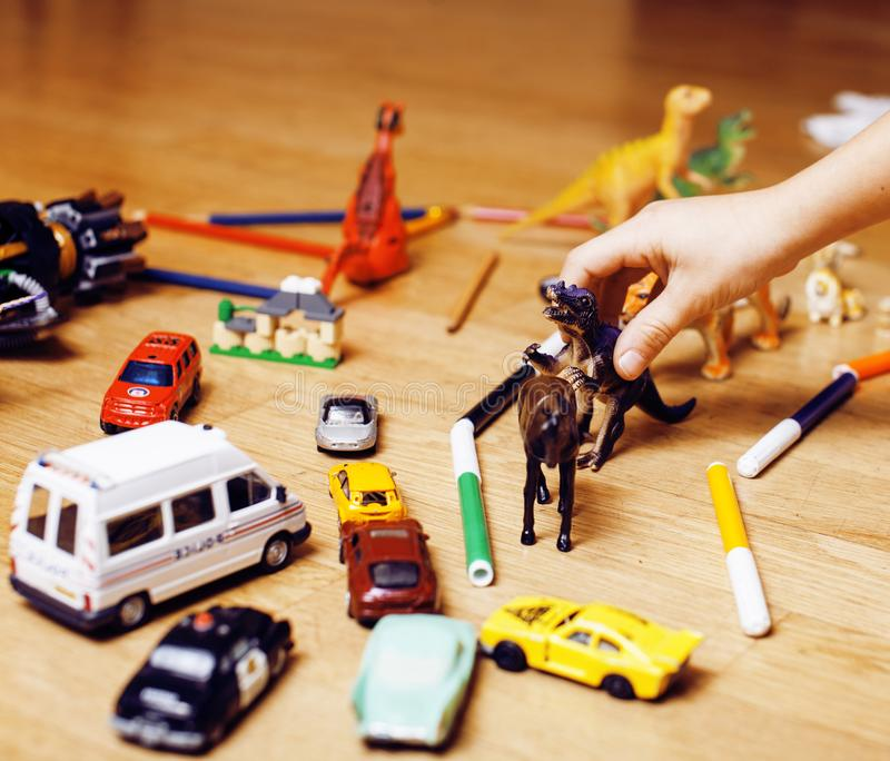 Children playing toys on floor at home, little hand in mess, free education. Lifestyle people concept royalty free stock images