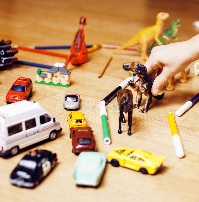 Children playing toys on floor at home, little hand in mess, free education. Lifestyle people concept stock images