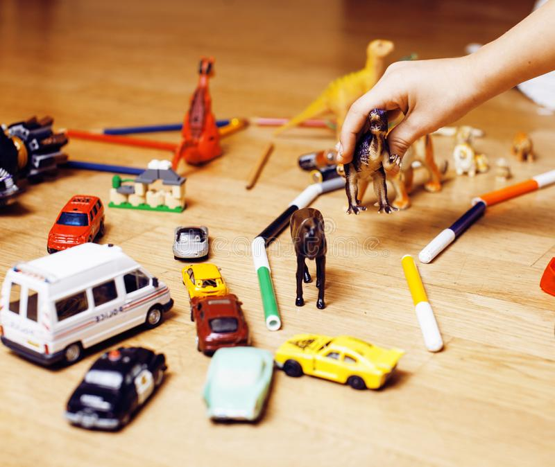 Children playing toys on floor at home, little hand in mess, free education. Lifestyle people concept stock photo