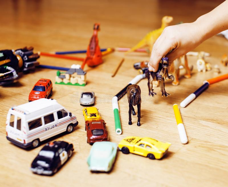 Children playing toys on floor at home, little hand in mess, free education. Lifestyle people concept royalty free stock photo