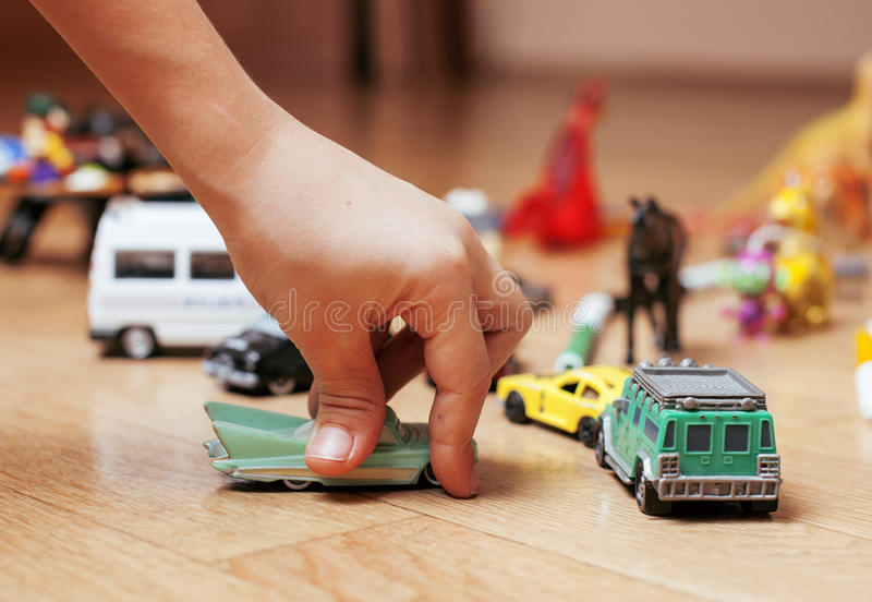 Children playing toys on floor at home, little. Hand in mess, free education concept stock photo