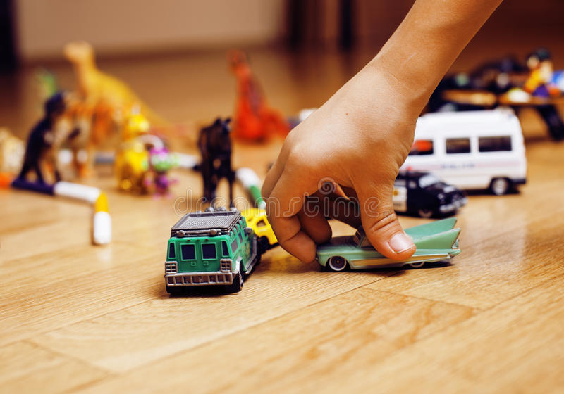 Children playing toys on floor at home, little hand in mess, free education. Lifestyle people concept stock photography