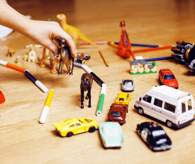 Children playing toys on floor at home, little hand in mess, free education, lifestyle people concept. Closeup royalty free stock photos