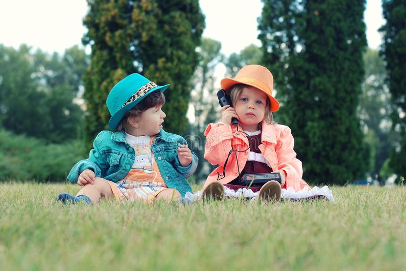 Children playing with toys outdoors royalty free stock photos