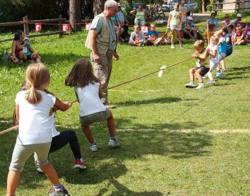 Children playing tug of war during summer games in S. Vigilio Marebbe Italy stock image