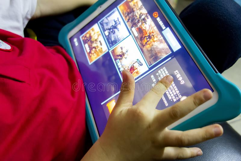 Children are playing video games. stock image