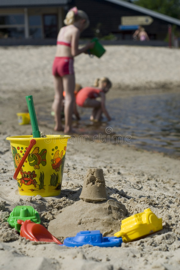 Children playing in the water. Children are playing in the water-line stock image