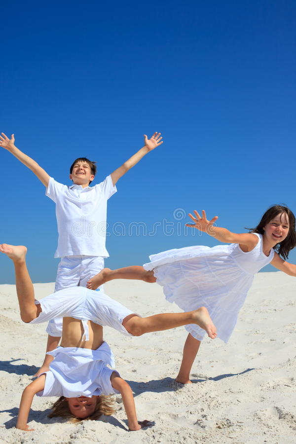 Download Children Playing On White Sand Stock Photo - Image: 13759628