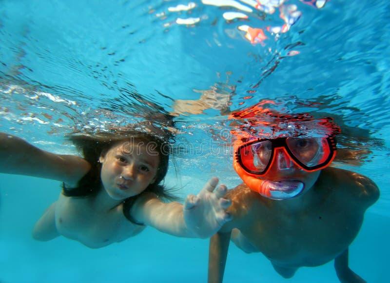 Children in pool stock photos