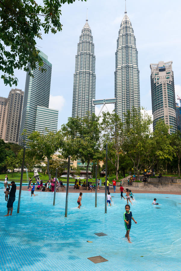Children at a pool in Kuala Lumpur swimming royalty free stock photo