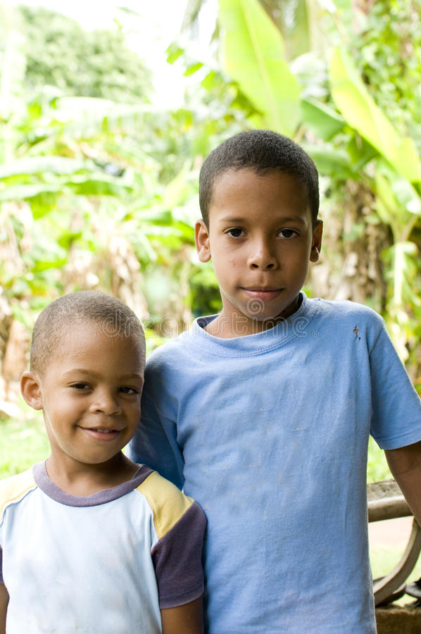 Children portrait Corn Island Nicaragua. Two young children brothers smiling portrait with jungle tropical plants in background Big Corn Island Nicaragua Central royalty free stock photos