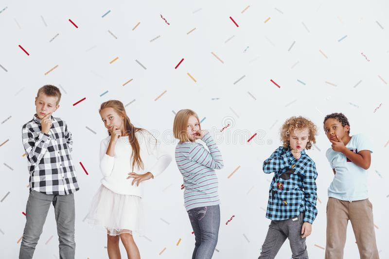 Children posing as thinkers stock photos