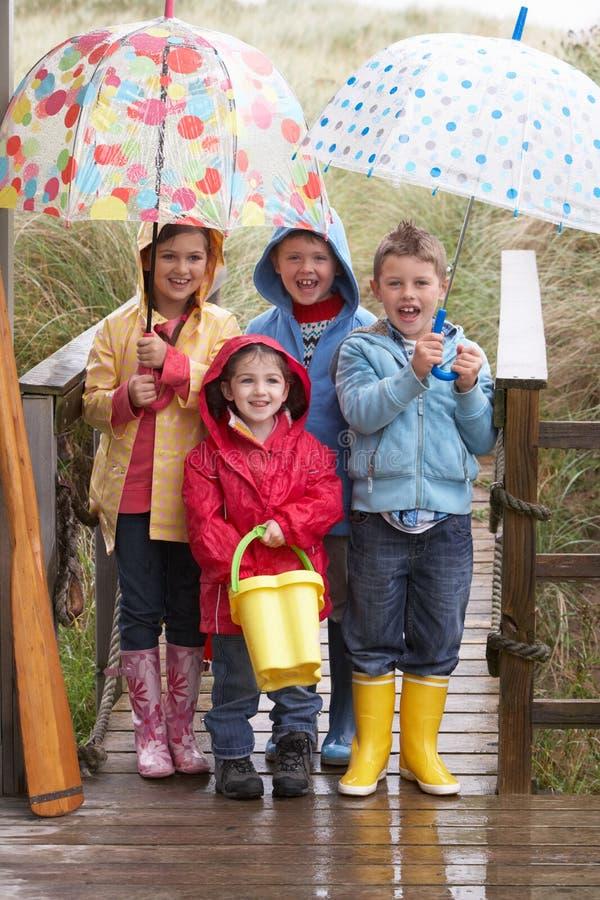 Children posing with umbrella stock photography