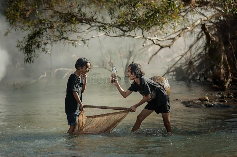 Download Rural Children Fishing At The River Stock Photo - Image of landscape, activity: 118120276