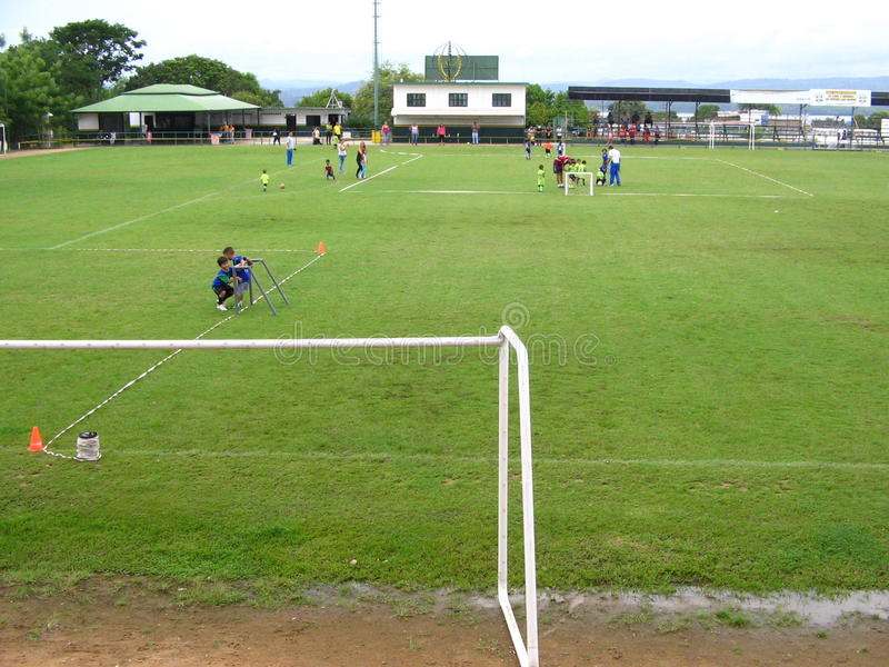 Children practicing soccer on a court in Puerto Ordaz city, Venezuela royalty free stock photo