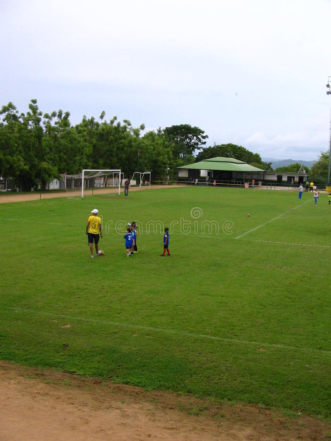 Children practicing soccer on a court in Puerto Ordaz city, Venezuela. Young children practicing soccer on a court in Puerto Ordaz city, Venezuela. Group of royalty free stock photos