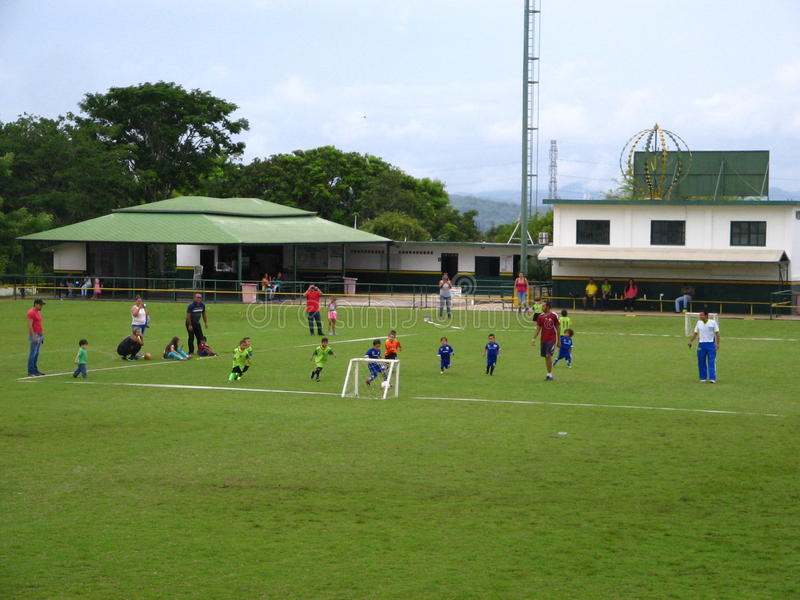 Children practicing soccer on a court in Puerto Ordaz city, Venezuela. Young children practicing soccer on a court in Puerto Ordaz city, Venezuela. Group of stock photo
