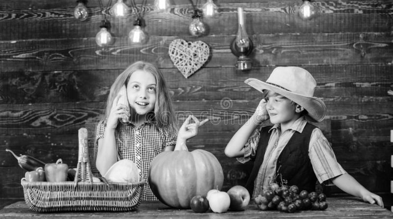 Children presenting farm harvest wooden background. Reasons why every child should experience farming. Held responsible. For daily farm chores. Kids farmers stock photo